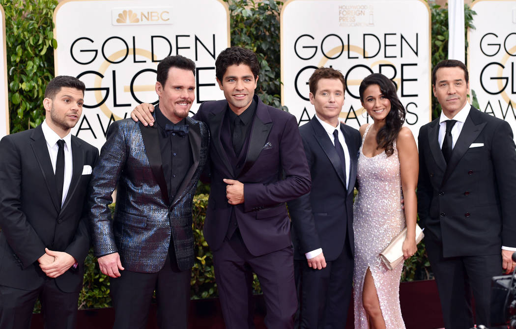 Jerry Ferrara, from left, Kevin Dillon, Adrian Grenier, Kevin Connolly, Emmanuelle Chriqui and Jeremy Piven arrive at the 72nd annual Golden Globe Awards at the Beverly Hilton Hotel on Sunday, Jan ...