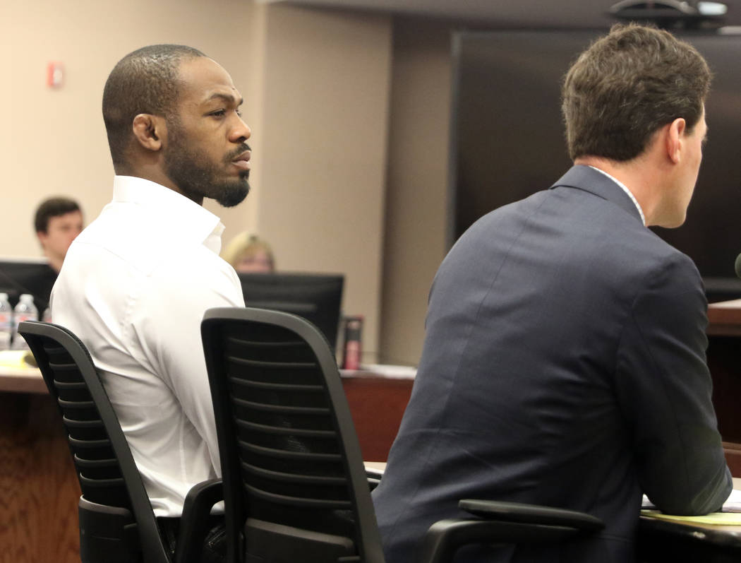 UFC light heavyweight champion Jon Jones, left, attends his licensing hearing before the Nevada Athletic Commission meeting in Las Vegas, Tuesday, Jan. 29, 2019. (Heidi Fang /Las Vegas Review-Jour ...