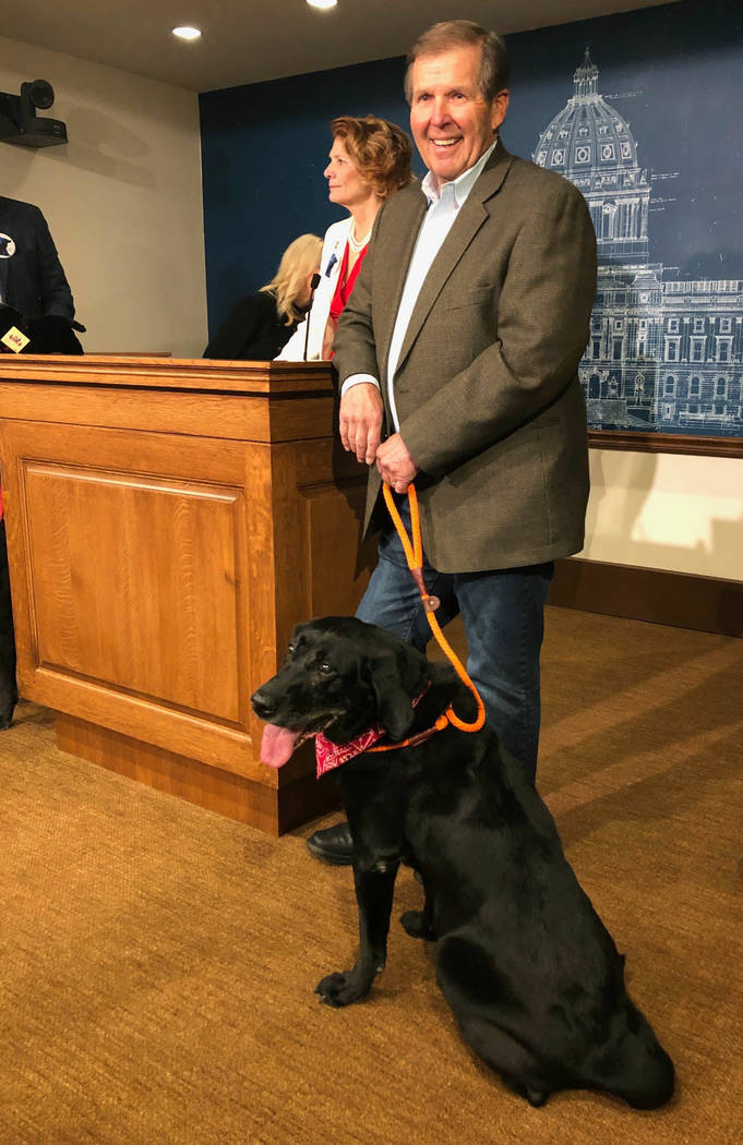 """Outdoor writer Ron Schara, host of the TV show """"Minnesota Bound,"""" and his dog, Raven III, appear at a news conference at the state Capitol on Tuesday, Jan. 29, 2019, in support of """" ..."""
