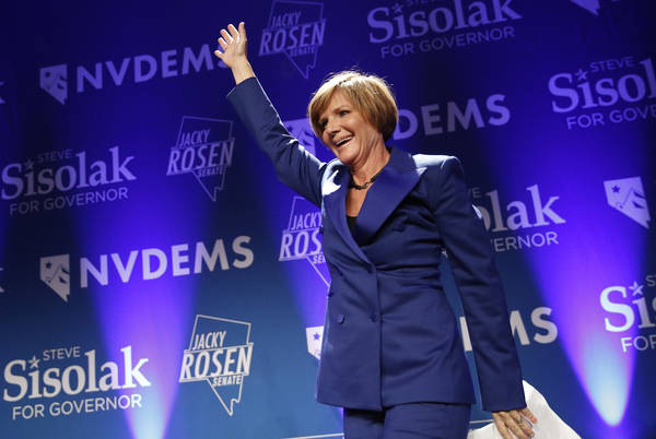 Rep. Susie Lee takes the stage at a Democratic election night party Wednesday, Nov. 7, 2018, in Las Vegas. (AP Photo/John Locher)