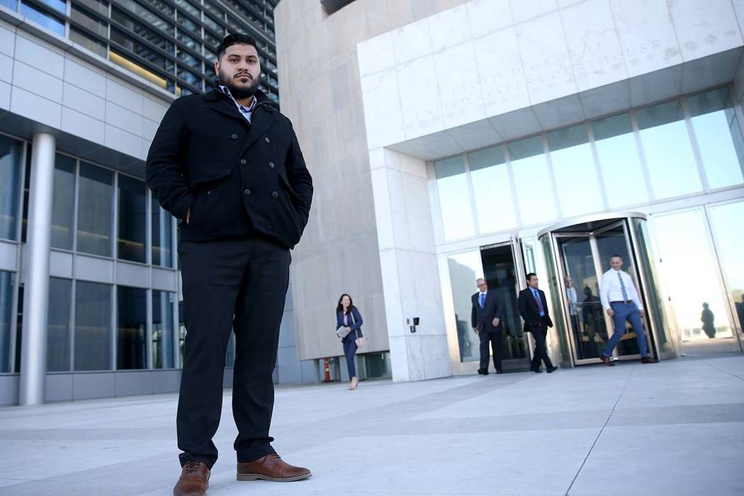 Angel Landeros stands in from of the Lloyd George Courthouse in Las Vegas Tuesday, Jan. 29, 2019, during a break in his civil rights lawsuit trial against the Metropolitan Police Department and th ...