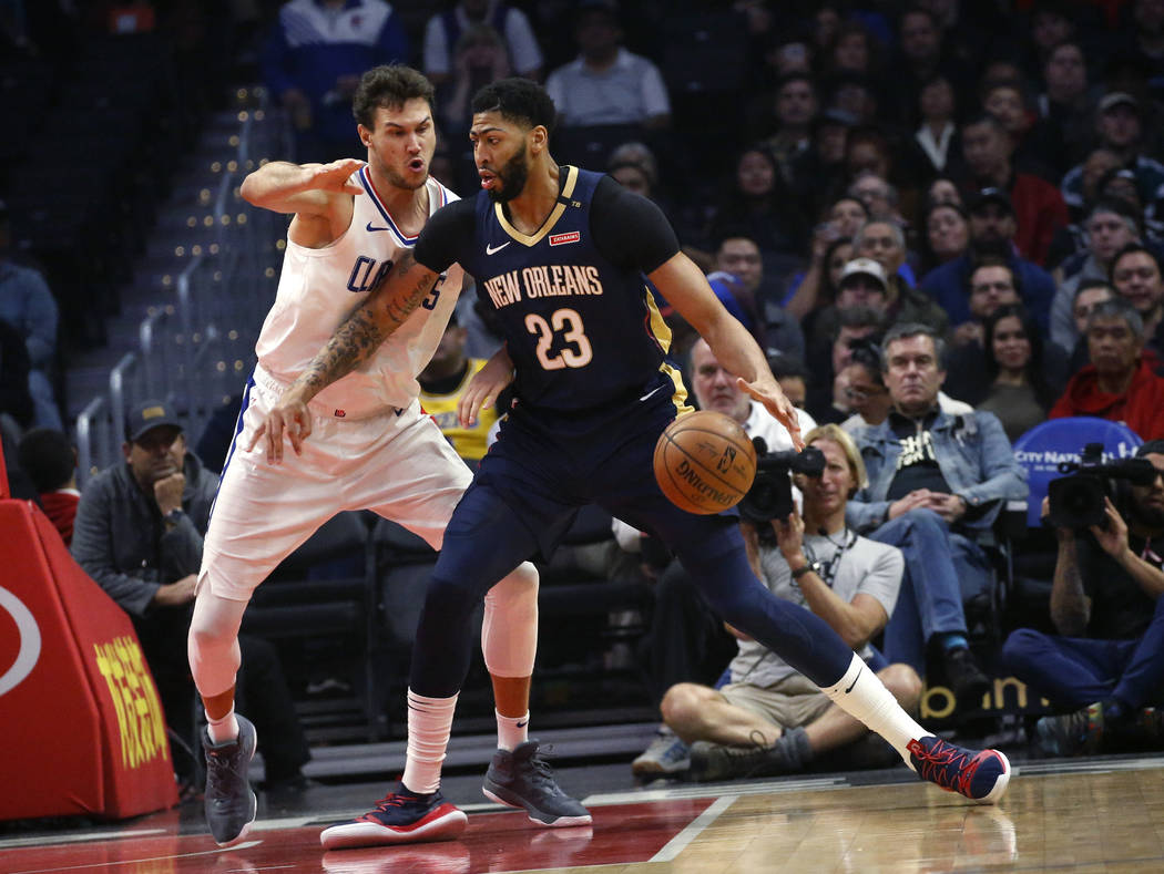 In this Jan. 14, 2019, file photo New Orleans Pelicans' Anthony Davis, right, dribbles against Los Angeles Clippers' Danilo Gallinari during the first half of an NBA basketball game in Los Angeles ...
