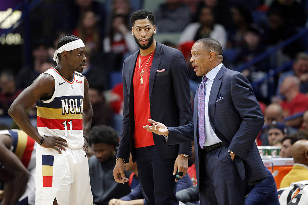 New Orleans Pelicans head coach Alvin Gentry talks to forward Anthony Davis and guard Jrue Holiday (11) in the second half of an NBA basketball game against the Detroit Pistons in New Orleans, Wed ...