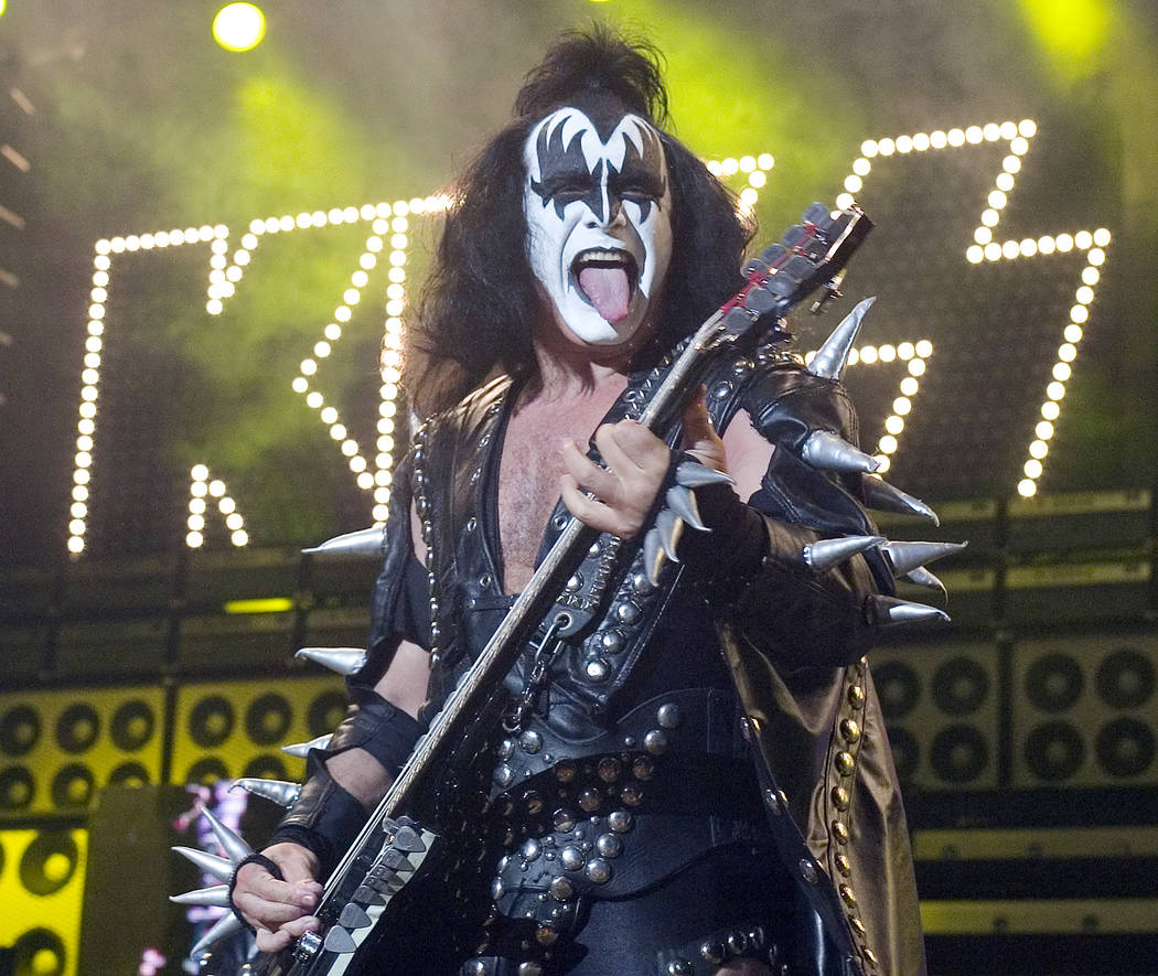 In this Tuesday, July 20, 2004 file photo, Gene Simmons, bass player for the band Kiss, performs during their performance at the PNC Bank Arts Center in Holmdel, N.J. The heavy metal veterans are ...