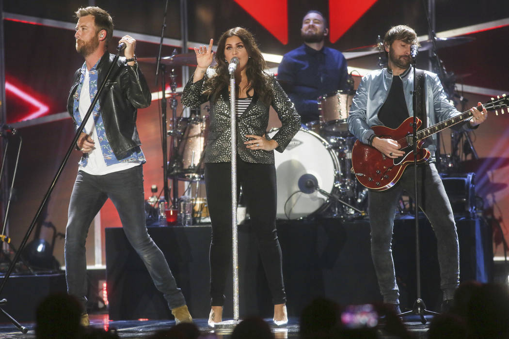 Lady Antebellum's Charles Kelley, Hillary Scott and Dave Haywood, from left, perform at the iHeartCountry Festival at the Frank Erwin Center on Saturday, May 6, 2017, in Austin, Texas. (Photo by J ...