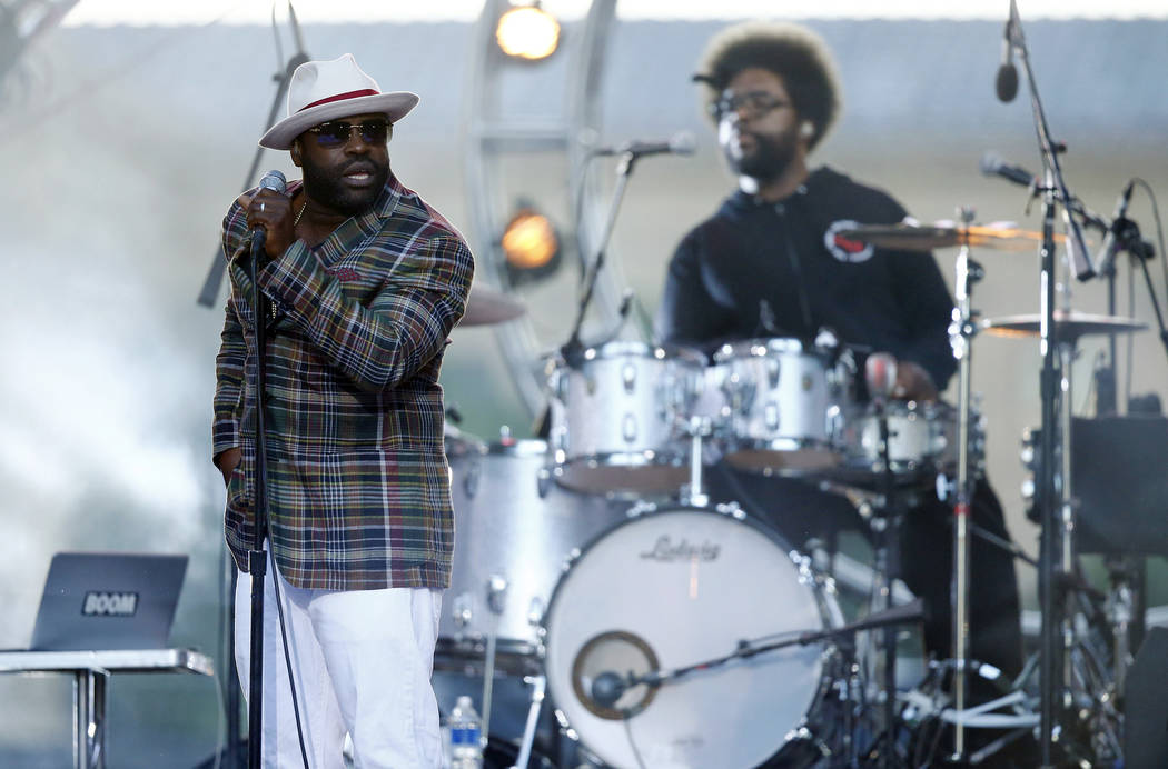 "In this July 4, 2014 file photo, Tariq ""Black Thought"" Trotter, left, and Ahmir ""Questlove"" Thompson of The Roots, perform during an Independence Day celebration in Philadelphia. The Roots are tap ..."