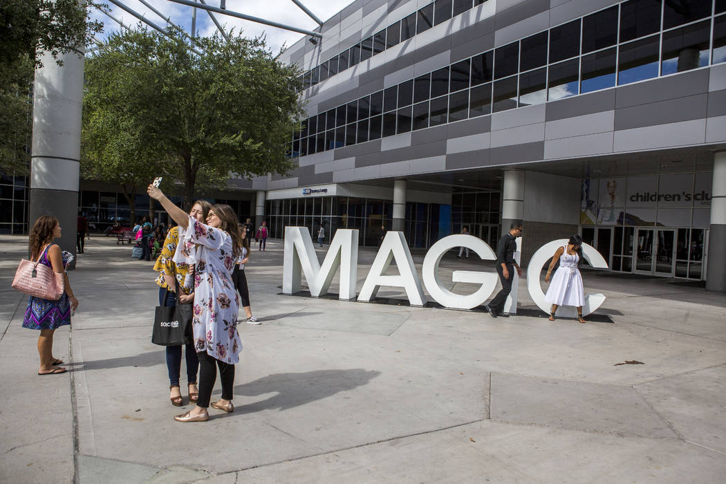 Attendees take photos near the MAGIC sign for the MAGIC trade show at the Las Vegas Convention Center on Monday, Aug. 14, 2017. Patrick Connolly Las Vegas Review-Journal @PConnPie