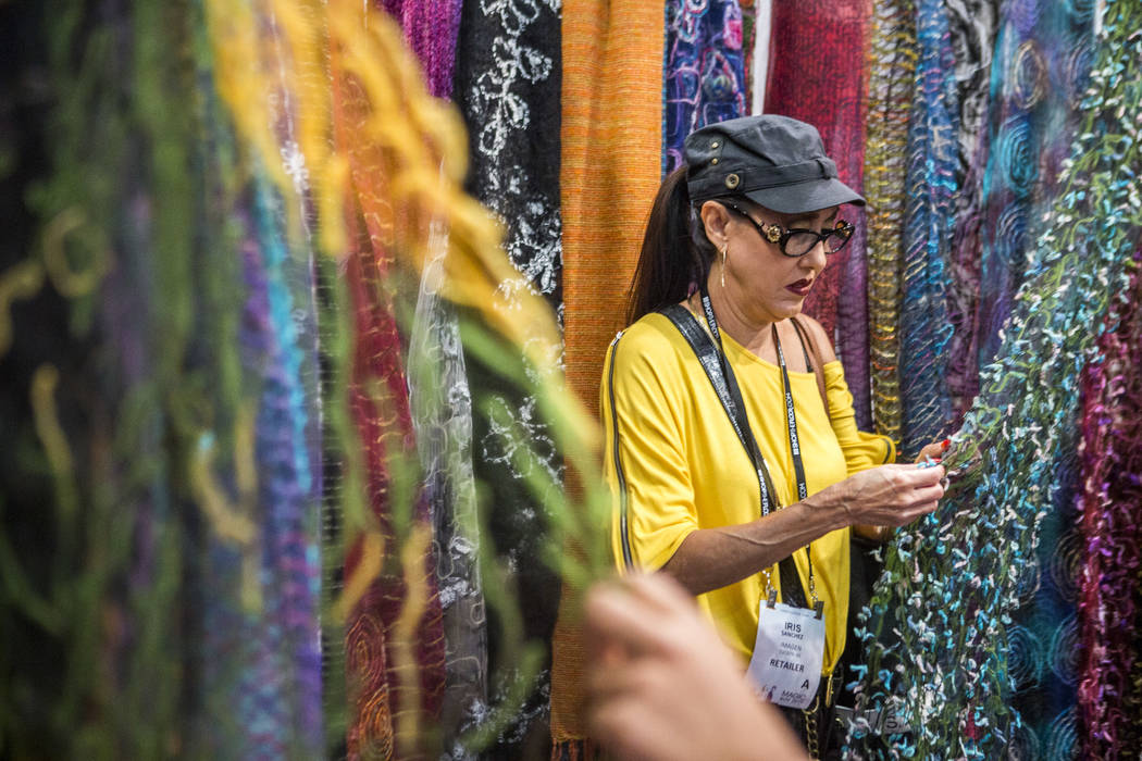 Iris Sanchez of Tucson, Arizona, browses scarves by Elegant Additions at the MAGIC trade show inside the Las Vegas Convention Center on Tuesday, Aug. 15, 2017. (Patrick Connolly/Las Vegas Review- ...
