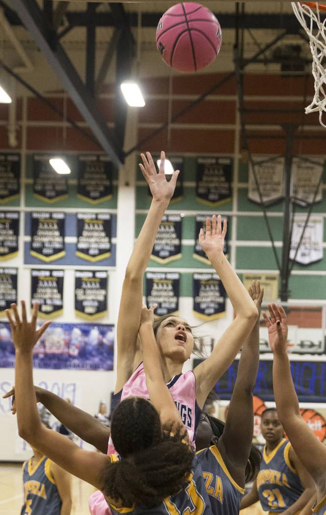 Shadow Ridge junior Christina Thames (32) shoots over Bonanza senior Macyn Raleigh (13) in the third quarter on Monday, Feb. 4, 2019, at Shadow Ridge High School, in Las Vegas. (Benjamin Hager/Las ...
