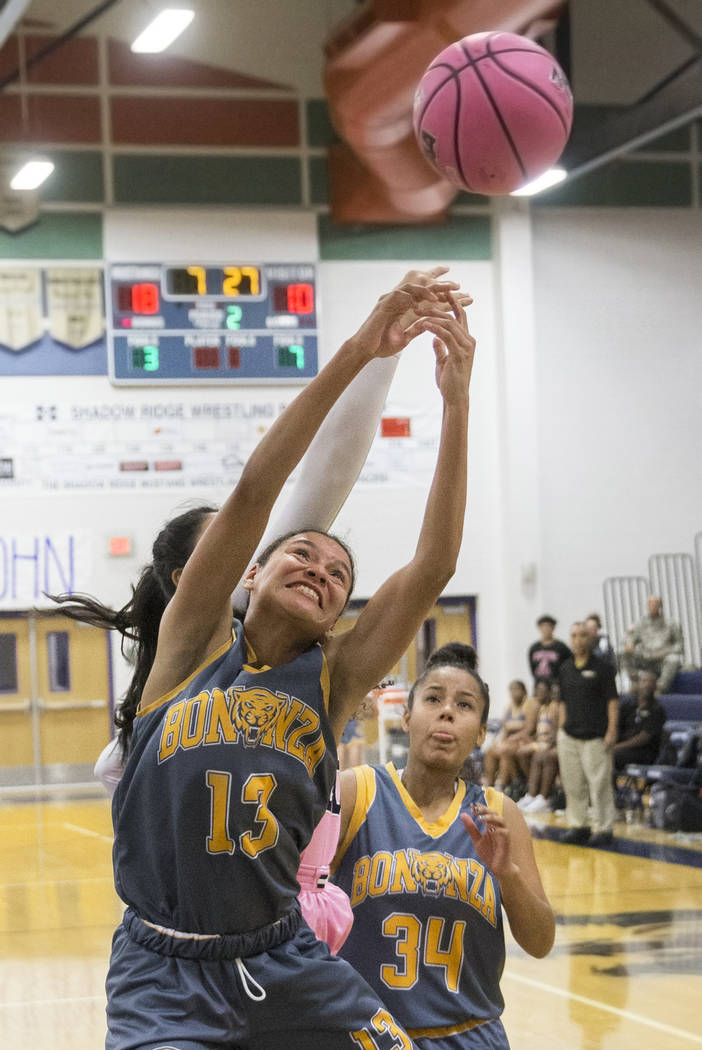 Bonanza senior Macyn Raleigh (13) fights for a rebound with Shadow Ridge sophomore Nadia Morales (20) in the second quarter on Monday, Feb. 4, 2019, at Shadow Ridge High School, in Las Vegas. (Ben ...