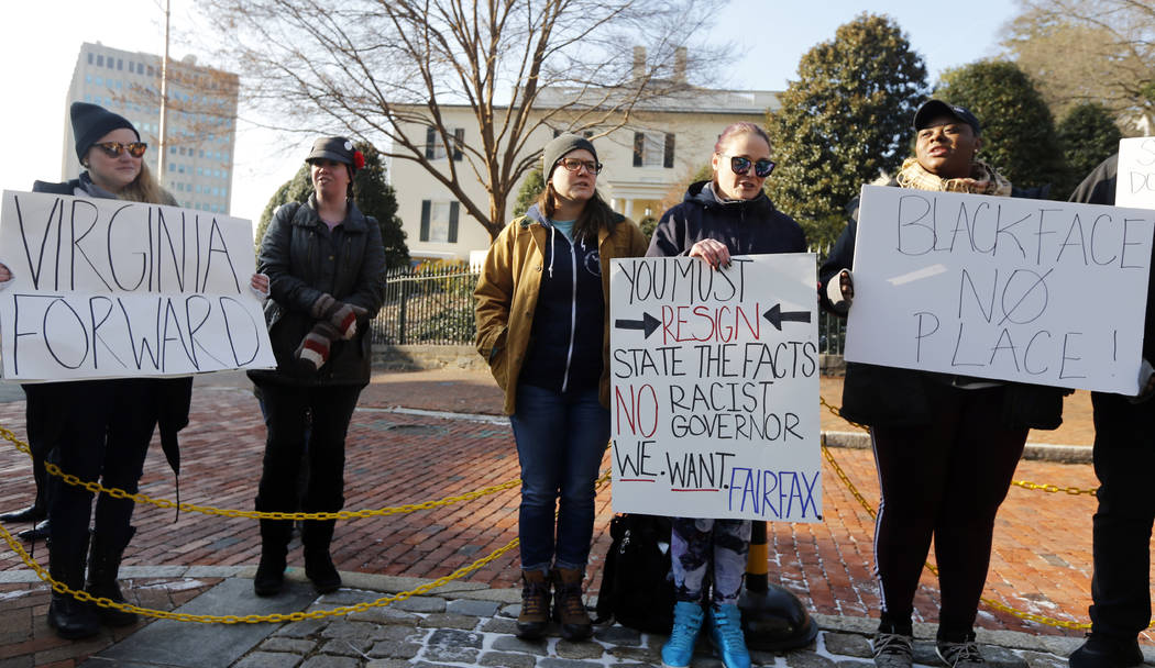 Demonstrators hold signs and chant outside the Governors Mansion at the Capitol in Richmond, Va., Saturday, Feb. 2, 2019. The demonstrators are calling for the resignation of Gov. Ralph Northam af ...