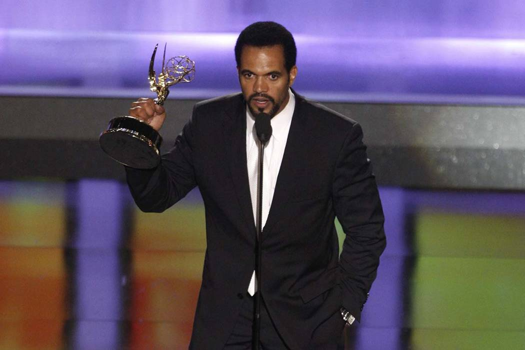 """In this June 20, 2008, file photo Kristoff St. John accepts the award for outstanding supporting actor in a drama series for his work on """"The Young and the Restless"""" at the 35th Annual Daytime Emm ..."""