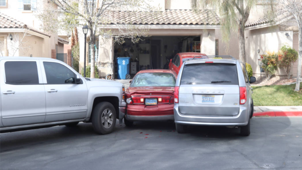 Las Vegas said Christopher Ashoff was in the red vehicle when he backed out of his garage and hit two Metro vehicles during an officer-involved shooting in the 500 block of Poplar Leaf Street on J ...