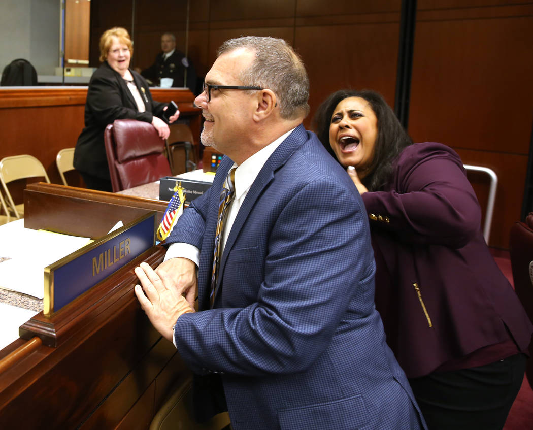 Assemblywoman Brittney Miller, D-Las Vegas, photo-bombs constituent Chris Miller of Las Vegas, who was posing in front of her name plate in the Legislative Building in Carson City on the first day ...