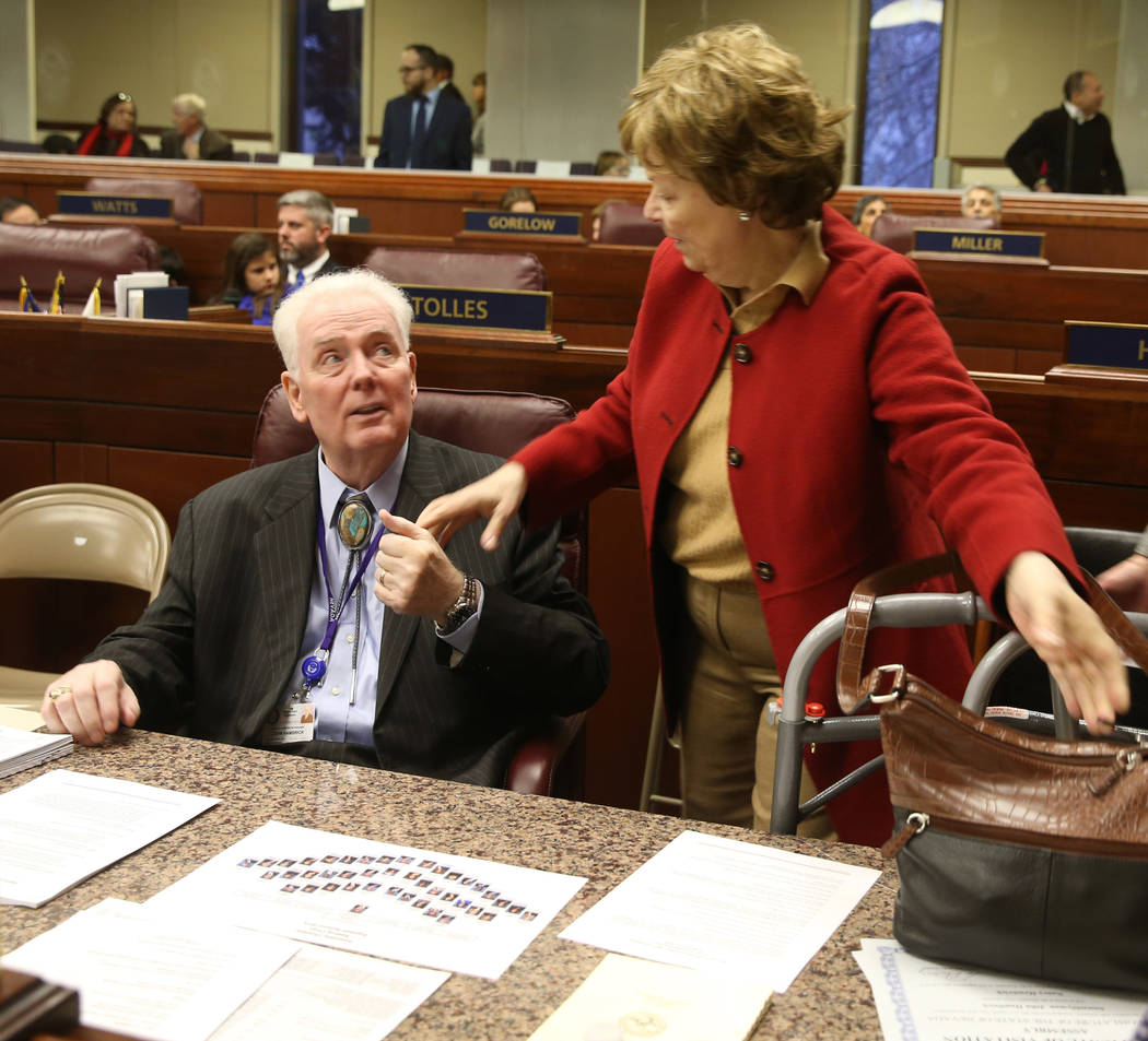 Assemblyman John Hambrick, R-Las Vegas, greets his wife Nancy Hambrick in the Legislative Building in Carson City on the first day of the 80th session of the Nevada Legislature Monday, Feb. 4, 201 ...
