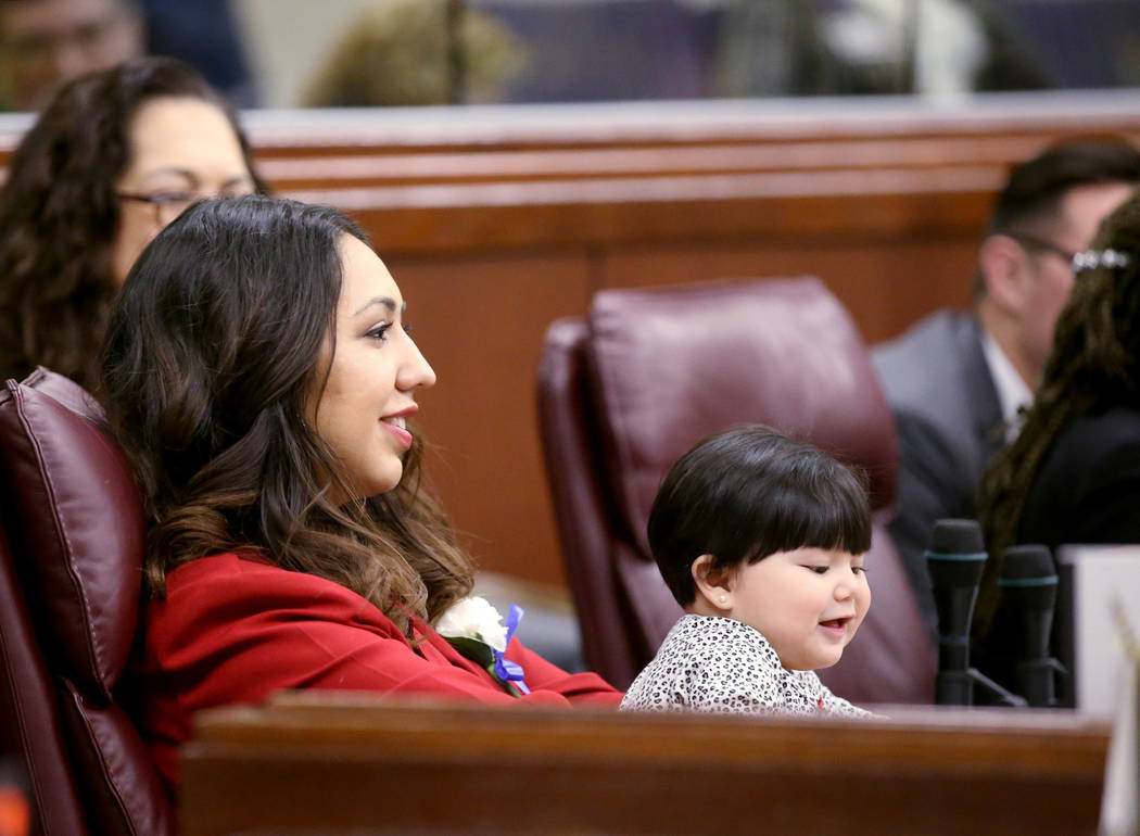 Assemblywoman Selena Torres, D-Las Vegas, holds her niece Sofia Elizabeth Penaloza, 10 months, in the Legislative Building in Carson City on the first day of the 80th session of the Nevada Legisla ...