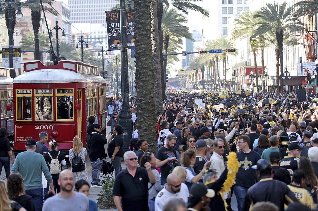 Who Dats make their way down Canal Street during the Blackout and Gold Second Line parade in New Orleans to protest the no call that likely cost the Saints a spot in today's Super Bowl on Sunday, ...