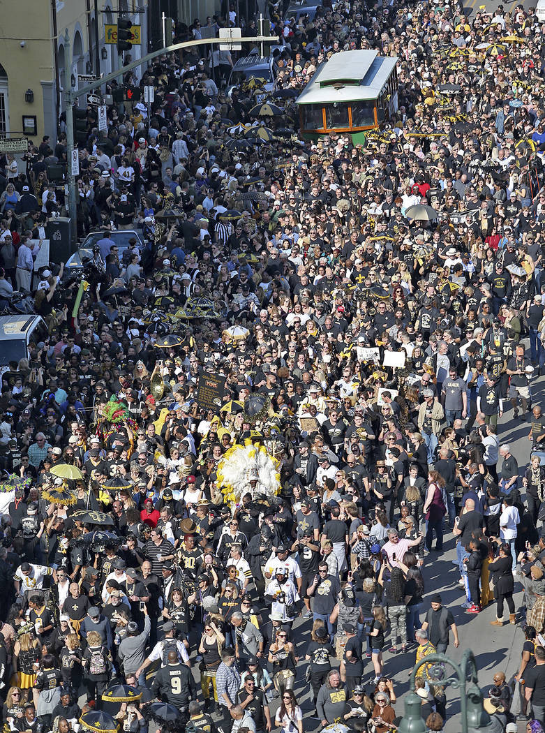 Who Dats fill North Peters Street during the Blackout and Gold Second Line in New Orleans to protest the no call that likely cost the Saints a spot in today's Super Bowl on Sunday, Feb. 3, 2019. ( ...