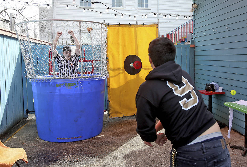 """Javier Guevara dunks """"referee"""" Sean Gordan at Dat Dog in the 3300 block of Magazine Street in New Orleans Sunday, Feb. 3, 2019, to protest the no call that likely cost the Saints a spot ..."""