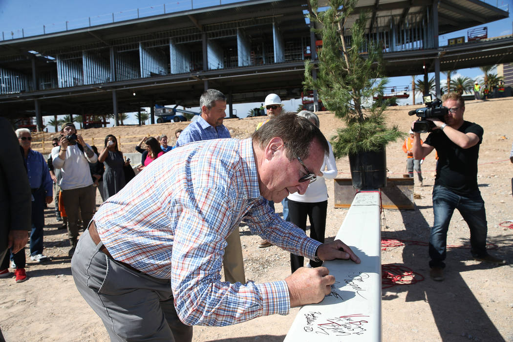 Retired Las Vegas Convention and Visitors Authority CEO Rossi Ralenkotter signs a steel beam during a topping off ceremony at the Las Vegas Ballpark construction site in Las Vegas, Thursday, Oct. ...