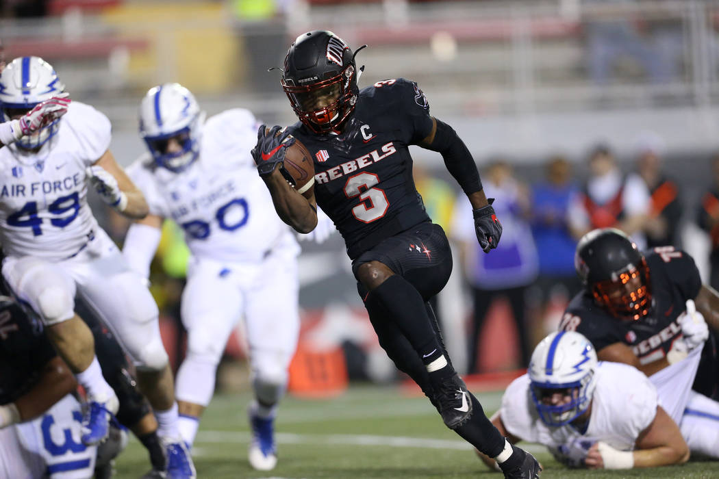 UNLV Rebels running back Lexington Thomas (3) runs for a touchdown in the third quarter against Air Force Falcons in the football game at Sam Boyd Stadium in Las Vegas, Friday, Oct. 19, 2018. (Eri ...