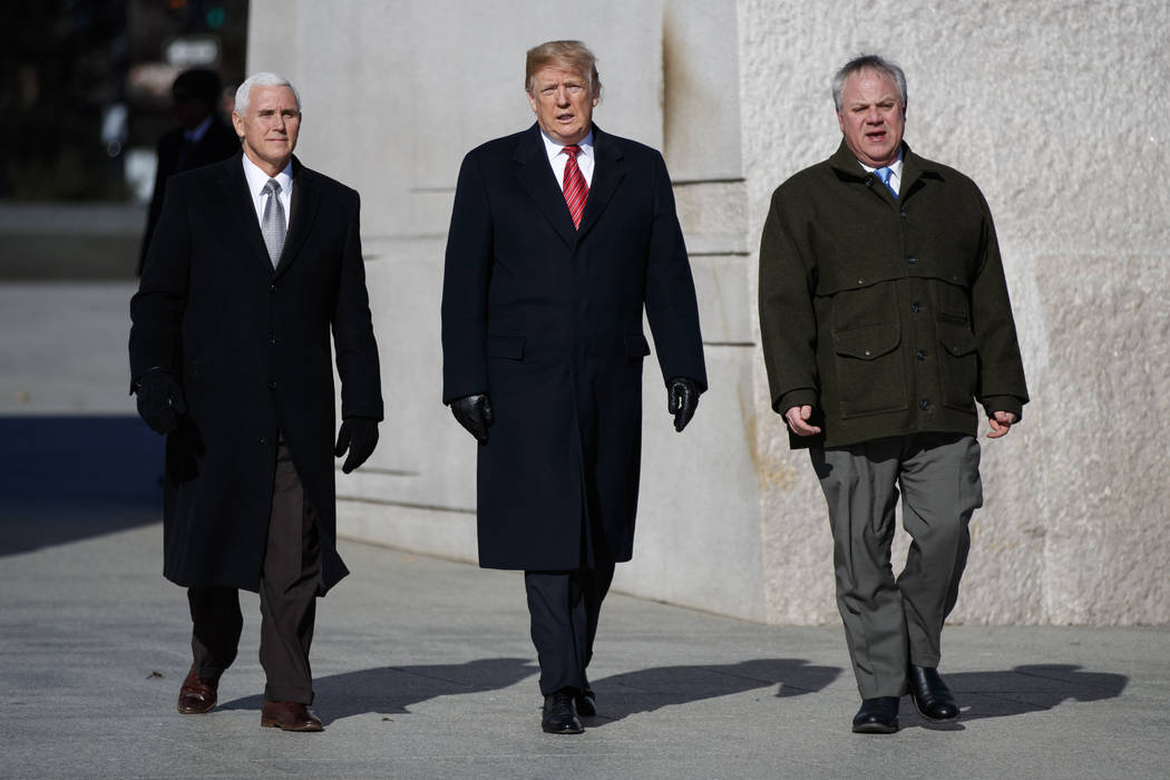 Vice President Mike Pence, left, and President Donald Trump walk with Acting Interior Secretary David Bernhardt as they visit the Martin Luther King Jr. Memorial, Monday, Jan. 21, 2019, in Washing ...