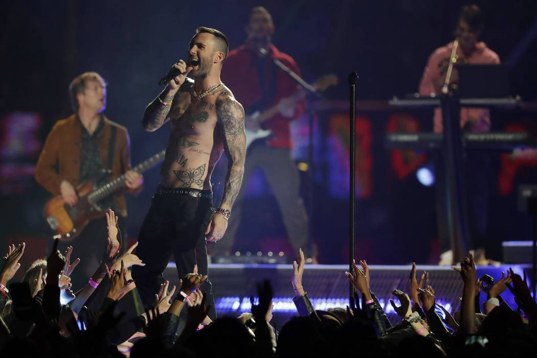 Adam Levine of Maroon 5 performs during halftime of the NFL Super Bowl 53 football game between the Los Angeles Rams and the New England Patriots Sunday, Feb. 3, 2019, in Atlanta. (AP Photo/Jeff R ...