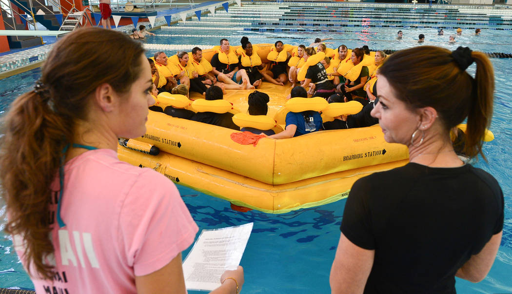 Instructors Ashleigh Markel, left, and Laurie Fortune lead a class of Allegiant Air flight attendant students in water and life raft training at the Heritage Park Aquatic Complex in Henderson on M ...
