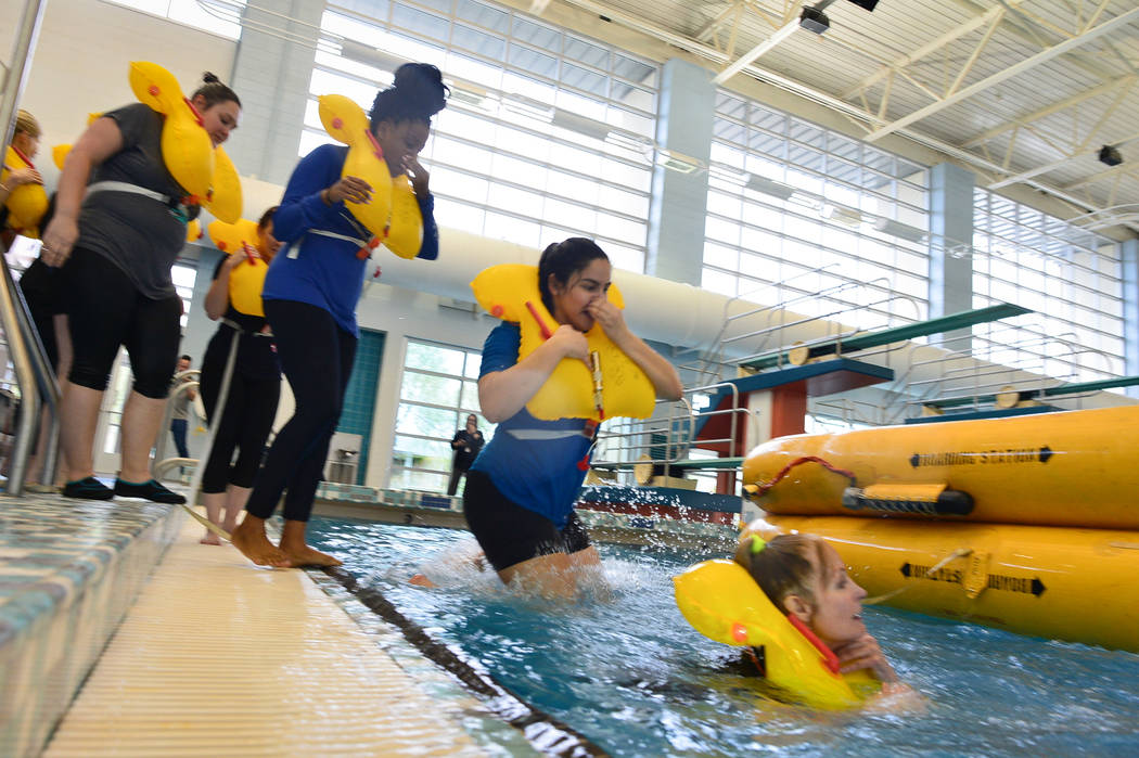 Allegiant Air flight attendant students line up to get into a life raft during training at the Heritage Park Aquatic Complex in Henderson on Monday, Feb. 4, 2019. (Brett Le Blanc/Las Vegas Review- ...