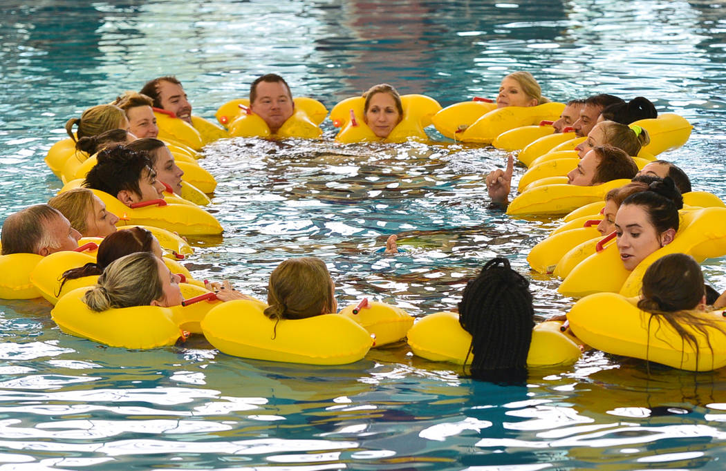 Allegiant Air flight attendant students participate in water and life raft training at the Heritage Park Aquatic Complex in Henderson, Nev., on Monday, Feb. 4, 2019. Brett Le Blanc Las Vegas Revie ...