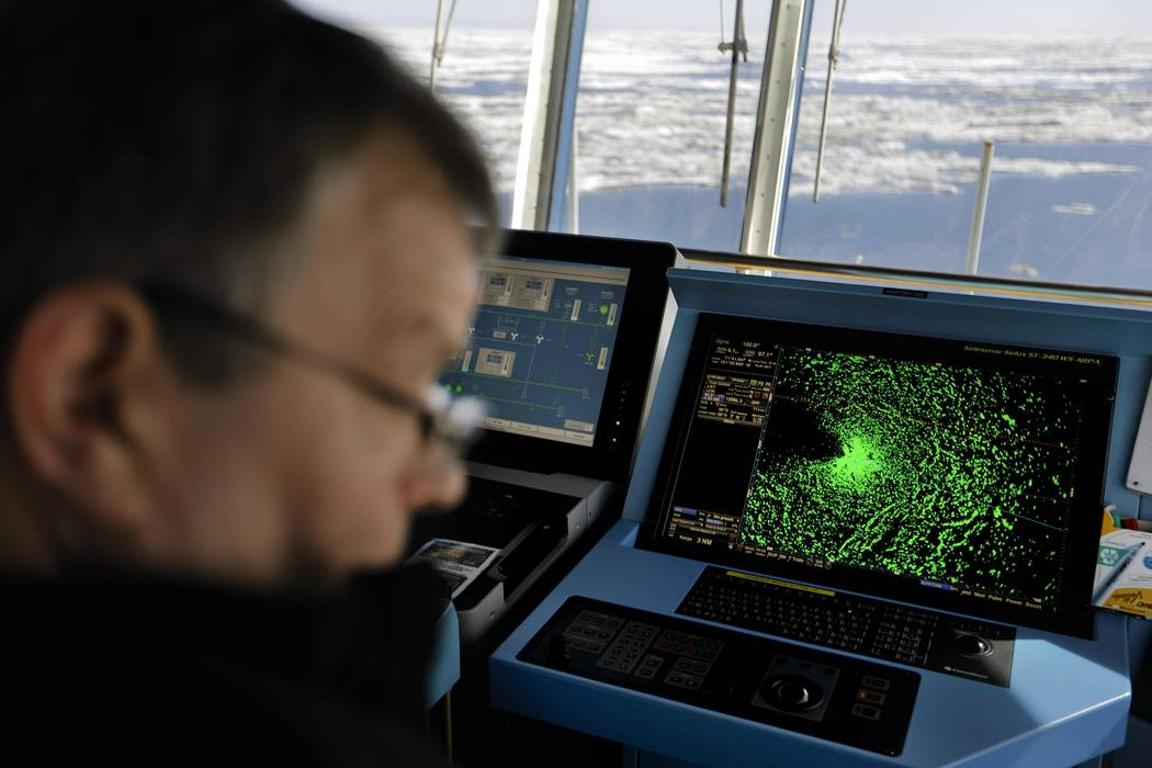 In this July 16, 2017, file photo a radar shows sea ice ahead of the Finnish icebreaker MSV Nordica as chief officer Harri Venalainen navigates the ship through the Beaufort Sea while traversing t ...