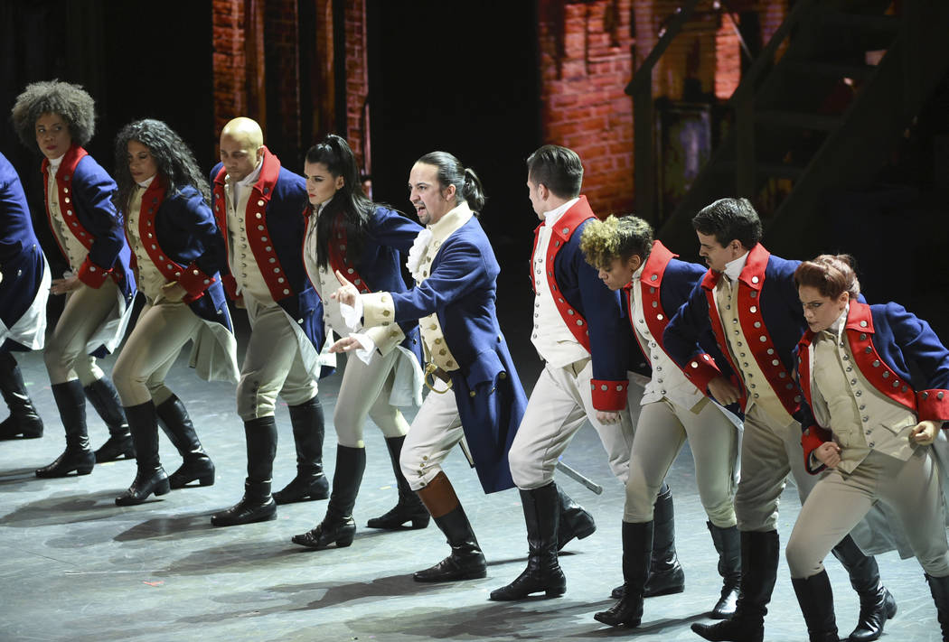 """In this June 12, 2016 file photo, Lin-Manuel Miranda, center, and the cast of """"Hamilton"""" perform at the Tony Awards in New York. Ever since the historical musical began its march to near-universal ..."""