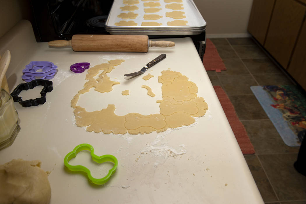 Leftover cookie dough sits out as Owner of Cakes, Cookies and Creations Jessica Dejarnett bakes ...