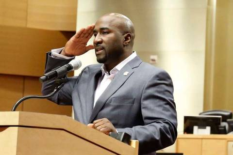 Las Vegas City Councilman Ricki Y. Barlow salutes after announcing his resignation during a pr ...