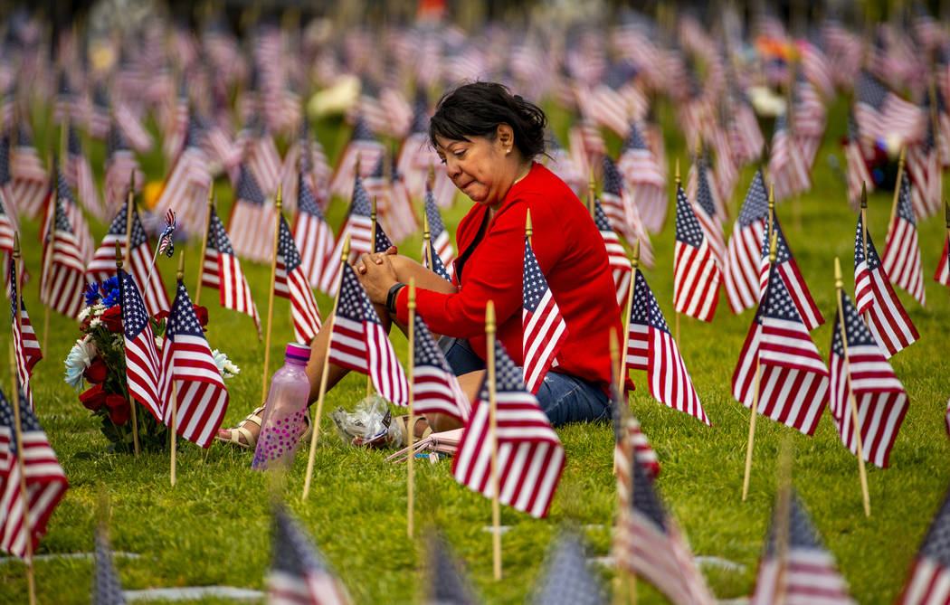 Vera Tourigny weeps while visiting her husband Raymond at the Southern Nevada Veterans Memorial ...