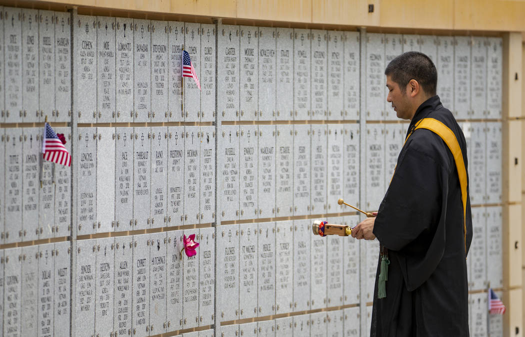 The Rev. Shoda Douglas with the Nichiren Buddhist Kannon Temple of Nevada says prayers for the ...