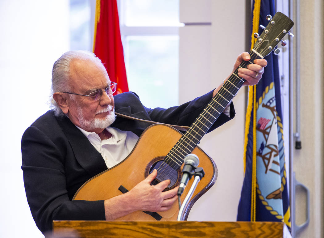 """Performer Phil Esser performs """"God Bless America"""" for the crowd during a Memorial Day ..."""