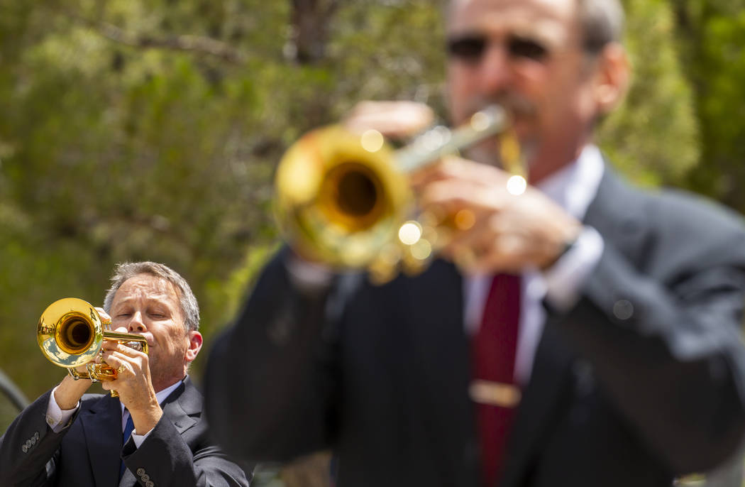 The Trumpeters Alliance perform Taps ending a Memorial Day ceremony at the Southern Nevada Vete ...