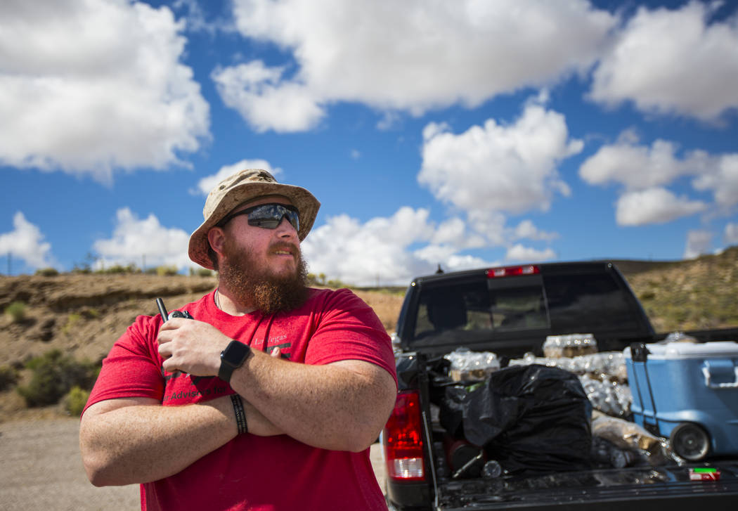 Sean Brown, president of UNLV Rebel Vets, looks on from a stop during a ruck march Friday, May ...