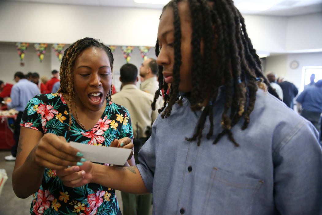 Inmate Trayvon Ward, right, 19, a former high school football standout from Las Vegas, shows hi ...