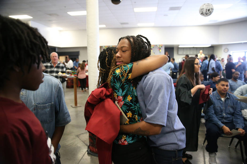 Inmate Trayvon Ward, right, 19, a former high school football standout from Las Vegas, embraces ...