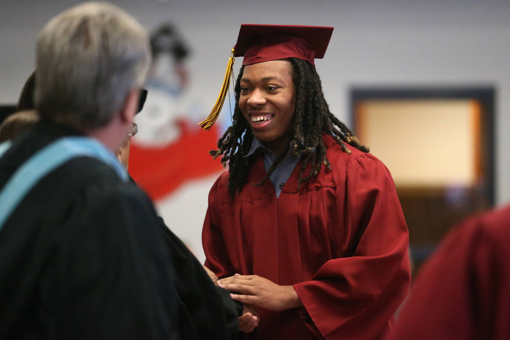 Inmate Trayvon Ward, 19, a former high school football standout from Las Vegas, graduates with ...