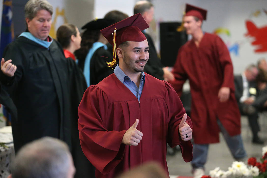 Inmate Gabriel Del Valle, 28, gestures as he graduates with a high school diploma, and certific ...