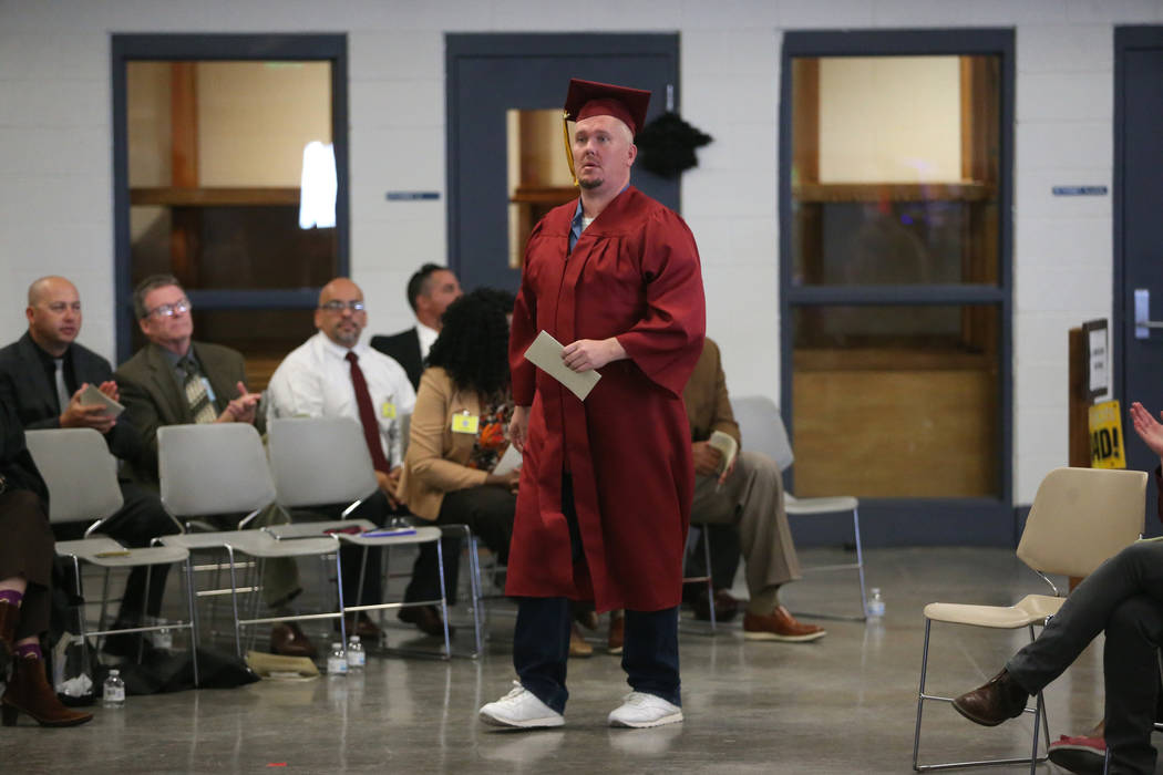 Inmate Jeremiah Valentine walks to be recognized during his graduation from the Adult High Scho ...