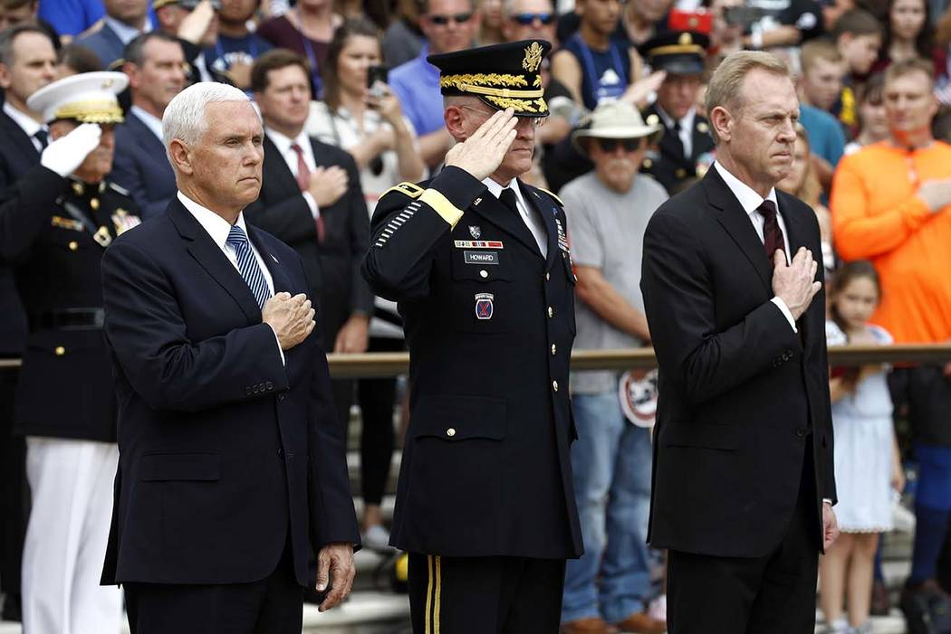 Vice President Mike Pence, from left, U.S. Army Maj. Gen. Michael Howard and Acting Defense Sec ...