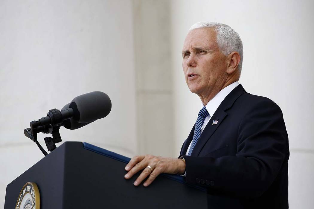 Vice President Mike Pence speaks at a Memorial Day ceremony after placing a wreath in front of ...