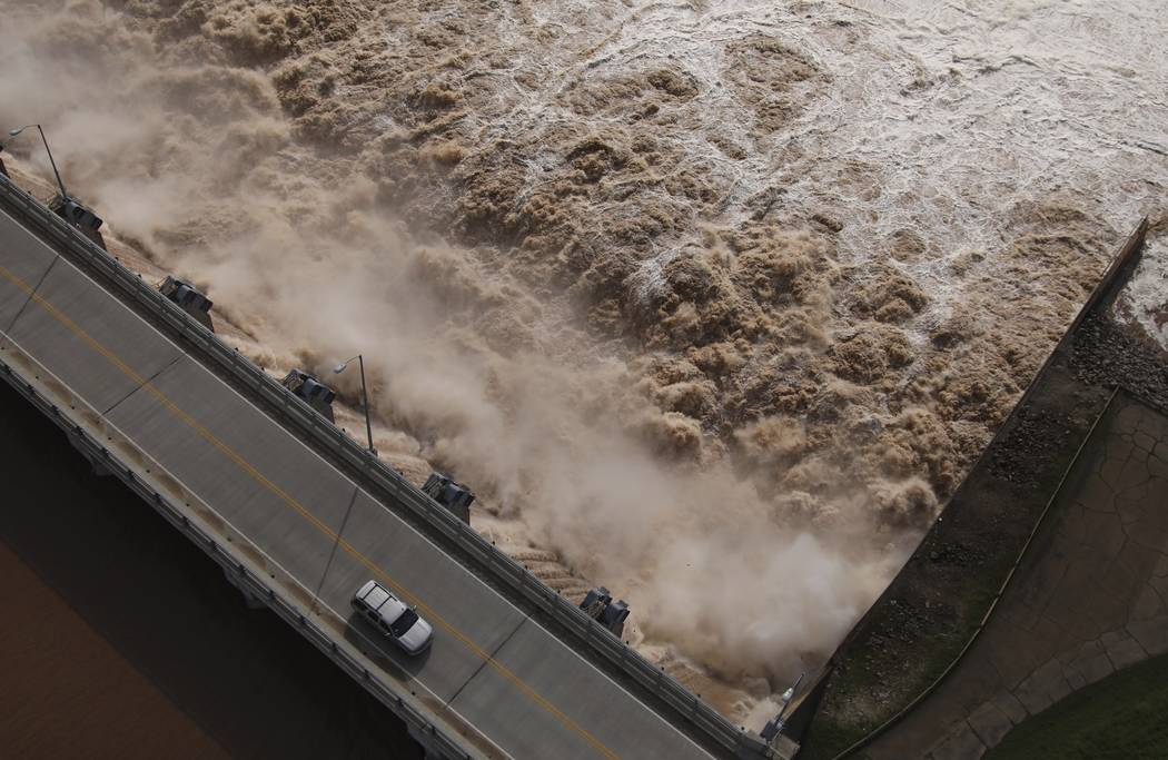 Water is released from the Keystone Dam into the Arkansas River northwest of Tulsa, Okla., Frid ...