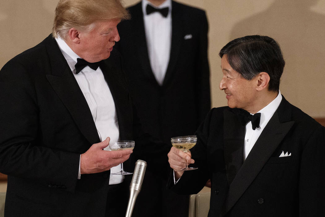 President Donald Trump toasts with Japan's Emperor Naruhito during a State Banquet at the Imper ...