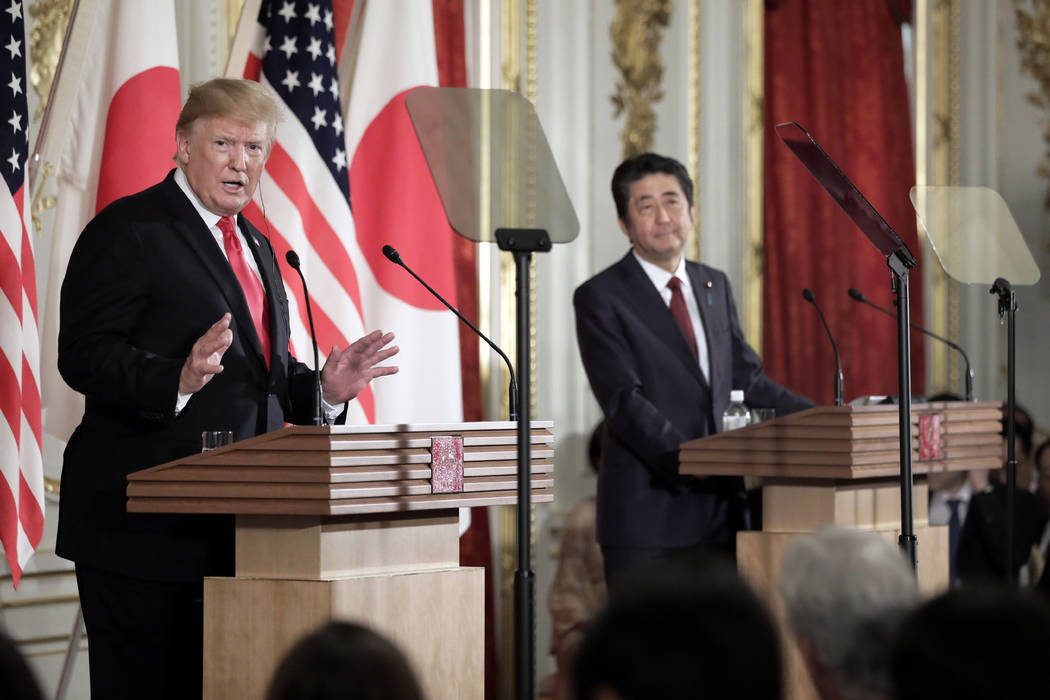 President Donald Trump, left, speaks as Japanese Prime Minister Shinzo Abe listens during a new ...