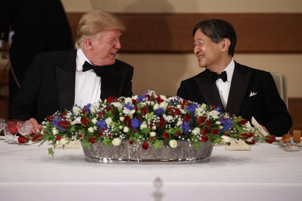 President Donald Trump talks with Japanese Emperor Naruhito during a State Banquet at the Imper ...